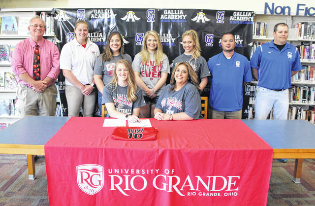 Gallia Academy senior Macey Siders, seated left, will continue her basketball career at the University of Rio Grande after signing with the program on Thursday, May 4, 2017, in the GAHS library in Centenary, Ohio. Siders is joined by her mother, Leighana Siders, at the table. Standing in back are Rio Grande women's coach David Smalley, Rio Grande assistant Brooke Marcum, McKenzie Siders, Morgan Siders, Maddie Siders, GAHS girls basketball coach Joe Justice and GAHS assistant Chris Tackett.
