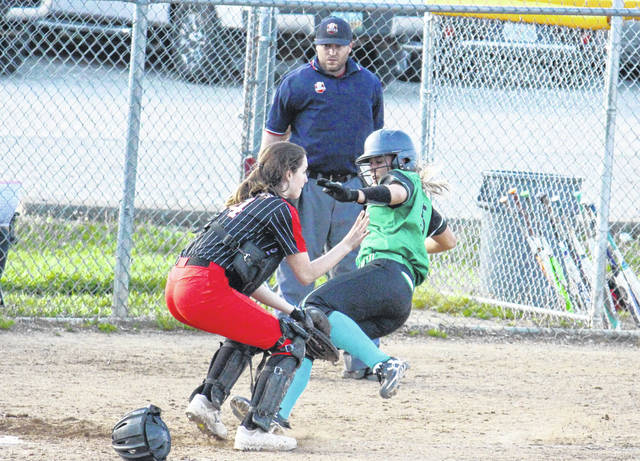 Eastern junior Cera Grueser (right) slides safely home, during the Lady Eagles' 7-6 loss to Alexander on Monday in Tuppers Plains, Ohio.
