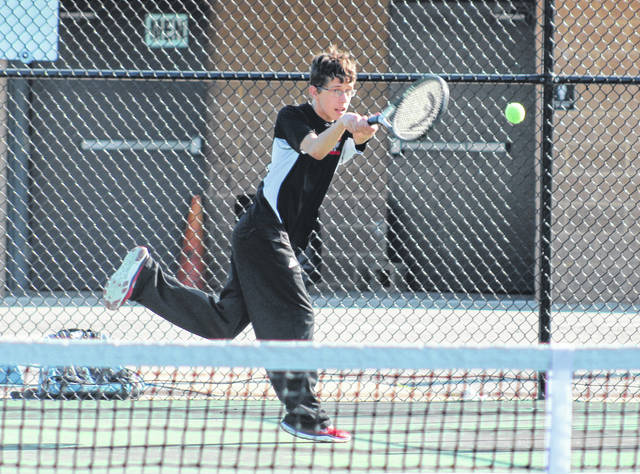 Point Pleasant junior Dawson Wilson hits a backhand return during an April 11 match against Huntington Saint Joseph at The Courts in Point Pleasant, W.Va.