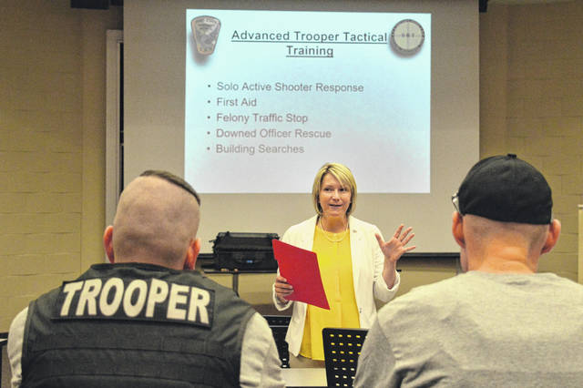 Dr. Michelle Johnston addresses area law enforcement as they prepare for SWAT training a few weeks ago at the University of Rio Grande and Rio Grande Community College.