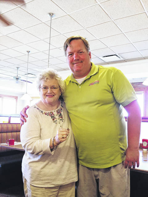Randy Stewart pictured with Cheryl Mitchell Escue after recovering her class ring which was lost for 57 years.