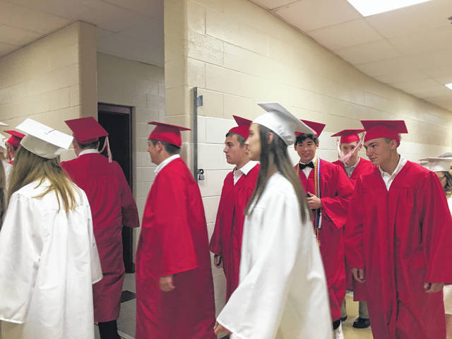 Wahama High School graduates leaving the cafeteria and making their way to the doors of the gymnasium.