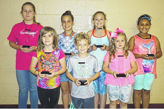 "Students who were presented the first ""Principal's Character Awards"" at New Haven Elementary School were front row, from left, Callie Stephens, Zahne Dangerfield and Ella Wright. Back row, from left, Angel Oldaker, Raegan Johnson, Katelyn Darst, and Kobe Moore. These awards were presented to students who were kind and courteous to everyone, followed the rules, and completed their work."
