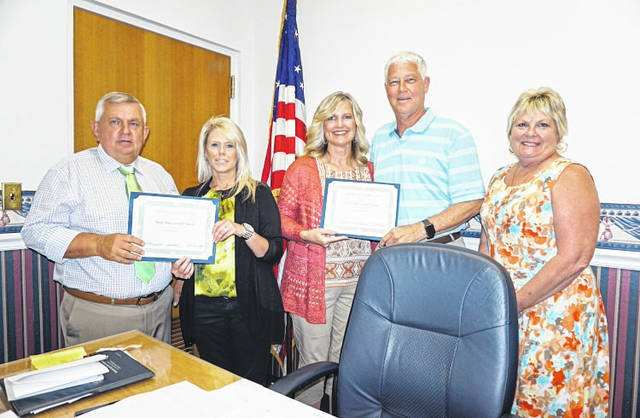 Twin Oaks Federal Credit Union, which has offices in Apple Grove and Point Pleasant, was recognized recently by the Mason County Commission for providing 41 years of service to the people of Mason and surrounding counties. Pictured, from left, are Commissioner Sam Nibert; Lori Byus, Twin Oaks Member Services Supervisor; Carrie Payne, Twin Oaks CEO; Commissioner Rick Handley; and Commission President Tracy Doolittle.