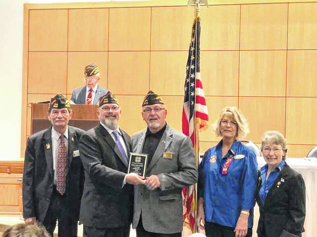 Stewart-Johnson V.F.W. Post 9926 Commander Ray Varian, third from left, is shown among a host of V.F.W. officials as he accepts the coveted District 2 Community Service Award. The Mason post was presented the award during the state convention, held at Camp Dawson in Kingwood.