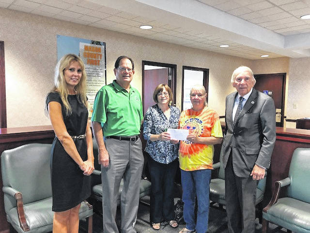 Those pictured are Christy Crowell, executive director of MCCF Inc., Dallas Kayser, Leeanne Kayser, Minnie Fowler, Camp Sunshine director, and Mario Liberatore, board chair of MCCF Inc.