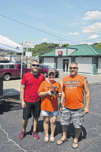 There were five BBQ teams competing in the BBQ cook-off during last weekend's Bikes & BBQ event. The Bikes & BBQ winners for barbecue included, first place, Team Hut with Tim and Teri Roush of New Haven, pictured with event organizer Gabe Roush.