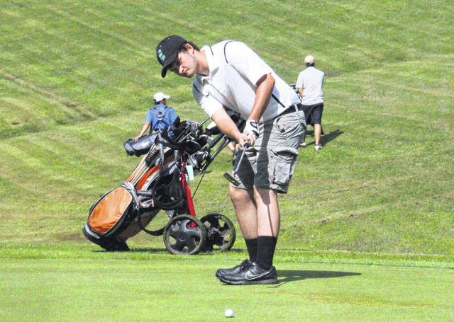 Ryan Harbour putts on the second green at the Meigs County Golf Course, during the Capehart Golf League on Monday in Pomeroy, Ohio.
