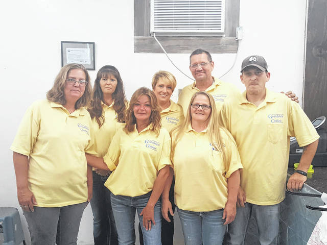 Grandview Outlet of Middleport employees (front, from left) Alice Brown (Area Supervisor), Tina Backus, Store Manager Kenda Reynolds, James Kennedy, (back) Misty Ross, Tracy Moon and Stephen Hays.