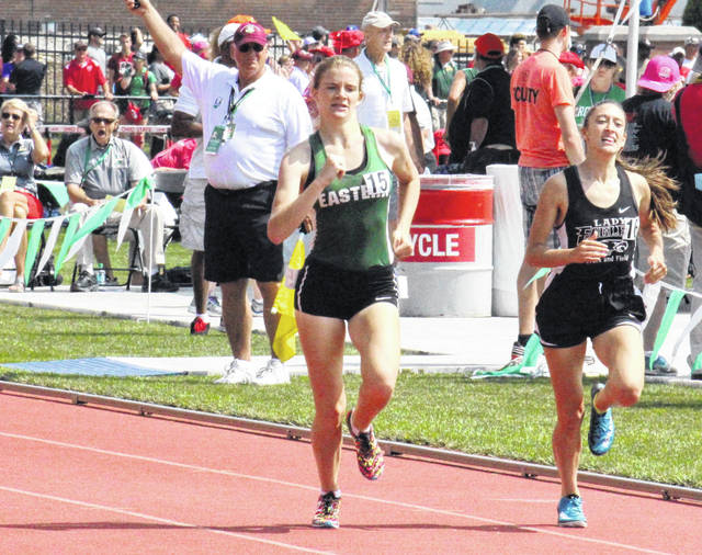 Eastern senior Jessica Cook (15) passes Belpre junior Sydney Sanders (16) in the final straightaway, during the OHSAA Division III 800m run championship race on Saturday at Jesse Owens Memorial Stadium in Columbus, Ohio.