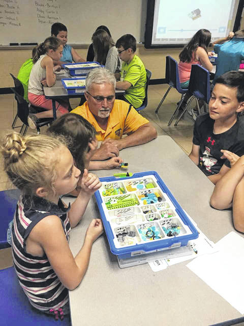 Gary Fields, a participant in the Tiger Men program at New Haven Elementary, is pictured as he helps second and fifth graders build LEGO robots, as part of a STEM project. Other Tiger Men assisting were Dan Riggs, Isaiah Pauley and Tom Grimm.