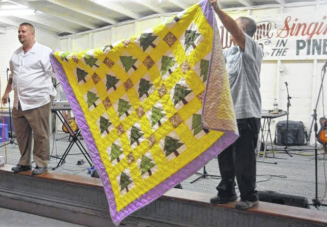 "A quilt featuring pine trees, made by Mazie Camp of Ashton, is given away each year during ""Singing in the Pines."" The event is set for this year on June 15 and 16 at the Union Campground. Pictured is the quilt from last year."