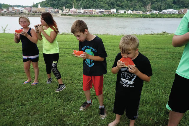 A watermelon eating contest will be among the festivities in the Bend Area on July 4. The contest, along with other games, will be held at the Stewart-Johnson V.F.W./Lottie Jenks Memorial Park in Mason. Pictured is a scene from last year's event.