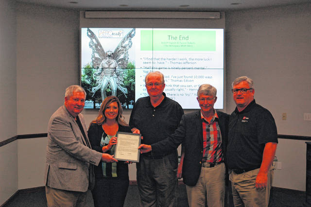 AEROready has certified Gallia County as viable and ready for the aerospace industry to develop and invest in. From left: Robert Ingram, AEROready, Melissa Clark, Gallia Economic Director, Harold Montgomery, Gallia County Commissioner, Tuscon Roberts, Aeroready, and Tim Wells, AEP Ohio Economic Development.