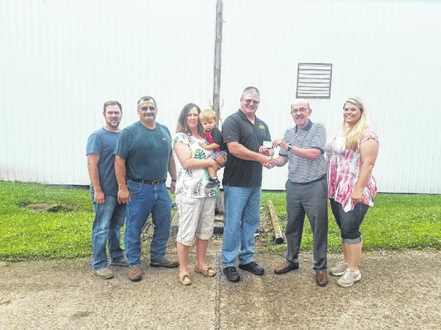 Todd Zuspan of A2Z Sanitation purchased the first 2018 Mason County Fair season pass. Those pictured from left to right are Matt Roush, board of director, Shawn Paugh, fair president, Michael Scott, Julie Zuspan, Todd Zuspan, Brian Billings, fair first vice president, and Vicki Hunt, fair treasurer.