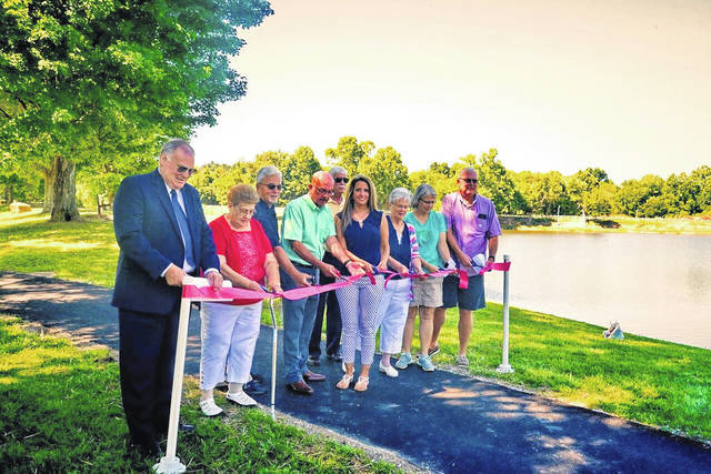 The official ribbon cutting of the Robert and Louise Claflin Walking Trail.