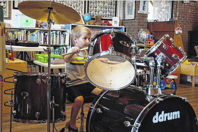 "Little Finn Hayman takes his turn at playing the drum set at the New Haven Library Tuesday, as part of the program ""The School of Rock."" The special event was presented as a part of the Summer Reading Program, and was also held at the Mason County Library in Point Pleasant."