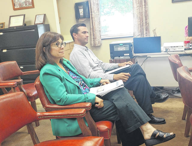 Gallia Engineer Brett Boothe and Gallia Deputy Engineer Beth Lozier speak with Gallia Commissioners Thursday regarding the possibility of applying for grants to finish paving Gallia roads and creating a smart corridor.