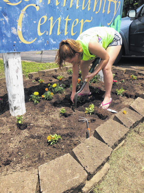 Members of the Busy 4's 4-H Club have kept busy in the community. They planted flowers at the Baden Community Center and helped out at their annual ice cream social.