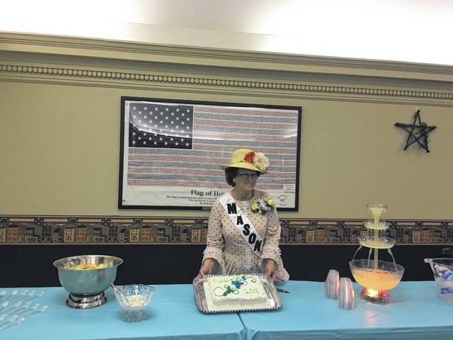 At the reception, refreshments were served and Mason County Belle Sharon Nibert was given the honor of cutting the cake.