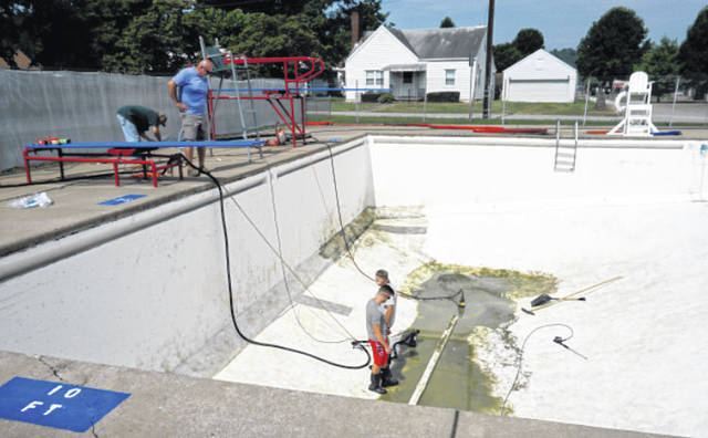 The New Haven Municipal Swimming Pool was drained Friday after concerns of dark water. Workers have been at the pool both Saturday and Monday, scrubbing and power washing, and it was scheduled to be refilled either late Monday afternoon or Tuesday. The pool will reopen later this week, with an extended swimming season planned until Labor Day.