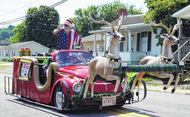 Uncle Sam or Santa Claus? Apparently Santa traded in his sleigh for a beetle this summer to participate in the New Haven Fourth of July parade Wednesday. He also traveled with the Mason parade before heading back to the North Pole for cooler weather. The Bend Area celebrated Independence Day with parades, followed by activities at the Mason park.