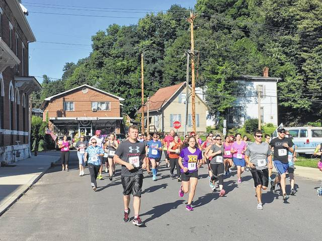 Runners make their way down Second Street as part of the Big Bend Blues Dash.