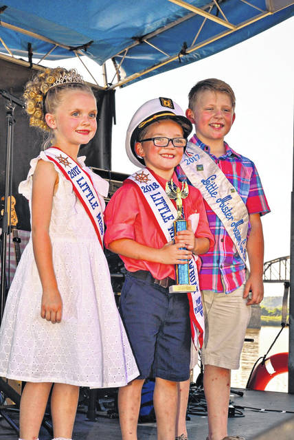 Bryson Sweeney, son of Brandy and Brandon Sweeney, was crowned the 2018 Little Mister Showboat by his brother, who is the current Little Mister Mason County and the 2016 Little Mister Showboat. Also pictured is Mary Supple, 2017 Little Miss Showboat.