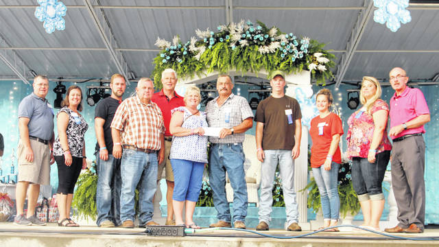 The Mason County Commission members gave a donation to the Mason County Fair Board members Monday evening at the fair.
