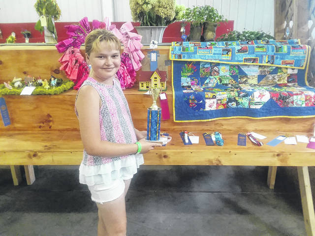 Annamae Keefer was the recipient of the Home Arts Department trophy having received the most blue ribbons.