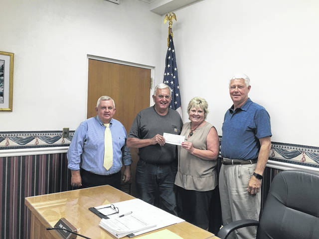 The Mason County Commission presented Lloyd Akers with a $2,000 donation for the West Virginia State Farm Museum.