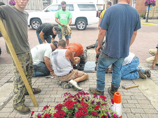 The installation of the memorial plaque at Hartley Square began at the end of July.