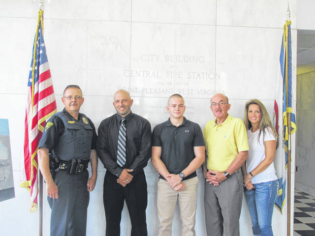 On Friday, two officers, Arron Payne and Jacob Massile, were sworn in to the Point Pleasant Police Department. Those pictured from left to right are Police Chief Veith, Officer Payne, Officer Massile, Mayor Brian Billings, and City Clerk Amber Tatterson.