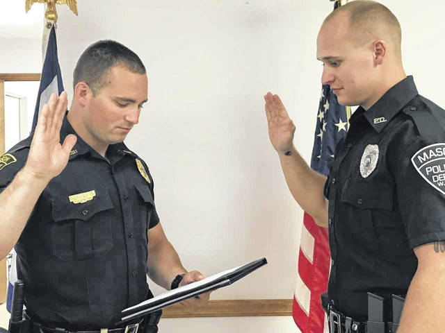 Mason Police Chief Colton McKinney, left, is pictured as he administers the oath of office to new Officer Tyler Doss of Point Pleasant. Doss began his duties as Mason's third full-time officer on Monday.