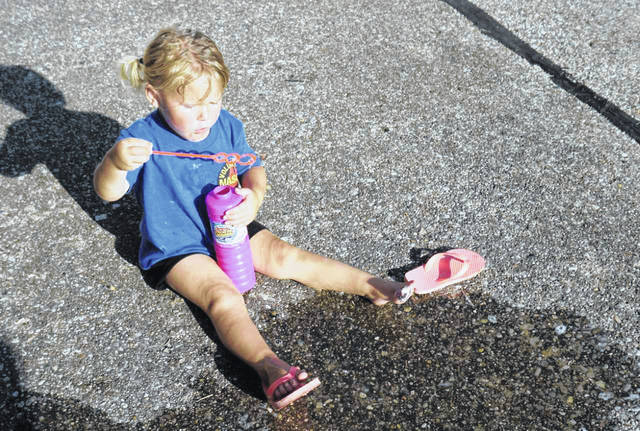 Bubbles, sidewalk chalk, jump ropes and hula hoops were provided for children to enjoy at the Back-to-School Bash in New Haven. Kids also brought their bikes, scooters and skateboards to enjoy while playing in the street. The main road was closed to traffic for the event.