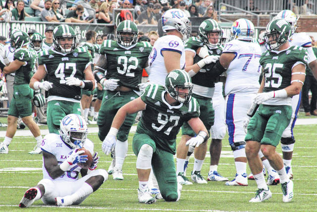 Ohio's Kent Berger (97) celebrates a tackle for a loss in front of teammates Evan Croutch (47), Cleon Aloese (92) and Tyler Gullett (25), during the Bobcats' 12-point win over Kansas Sept. 16, 2017 in Athens, Ohio.