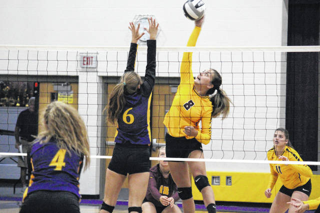 Meigs senior Marissa Noble (8) attempts a spike over Southern junior Phoenix Cleland (6) during the Lady Marauders' non-conference victory on Tuesday night in Racine, Ohio.