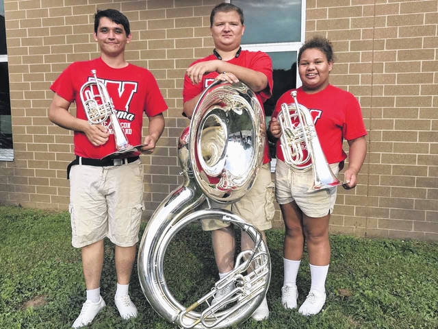 Wahama band students Aaron Beard, David Runyon and Quinel Jones, from left, show off the new instruments purchased with grant money from the Robert and Louise Claflin Foundation. The new horns replace ones that were all over 20 years old.