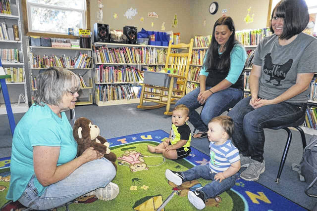 "Mason County Library Director Pam Thompson, left, is shown during the new ""Tot Time,"" being held at all three libraries. The program is a lap-sit for children ages birth to 36 months. Also pictured are Elin Weaver with his mother, Danni Marie, center, and Oliver Smith with his mother, Betsy. The half-hour sessions will allow time for the babies to interact, and parents to fellowship."