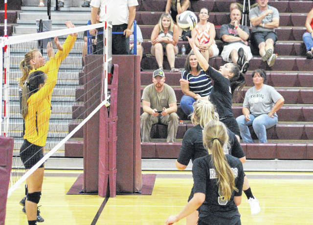River Valley junior Jaden Bradley, right, hits a spike attempt at a pair of Meigs blockers during Game 4 of Tuesday night's TVC Ohio volleyball opener at Larry R. Morrison Gymnasium in Rocksprings, Ohio.
