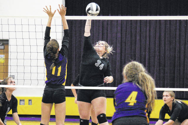 River Valley senior Kelsey Brown (34) attempts a spike, during the Lady Raiders straight games victory on Monday in Racine, Ohio.