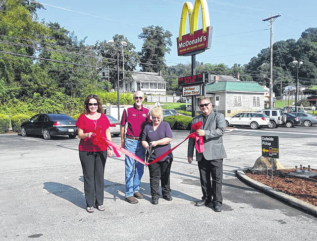 Following a four-week inside and outside total renovation, McDonald's of Pomeroy held its Grand Re-Opening on Monday morning. The four week project was a little over a $1 million investment in the restaurant, bringing in the latest in technology with ordering kiosks, LED menu boards and other upgrades. In addition, servers will now bring orders to the customers at their seats following their orders placed at the new kiosks. The restaurant is having special deals throughout the week to mark the event. Taking part in the ribbon cutting event on Monday morning were owners Greg and Teresa Mills, the Meigs County Commissioner's Office, American Legion Post 39 and others. Greg Mills presented a donation to the American Legion for their part in the event, as well as the Racine Volunteer Fire Department for their assistance in cleaning up after the construction.