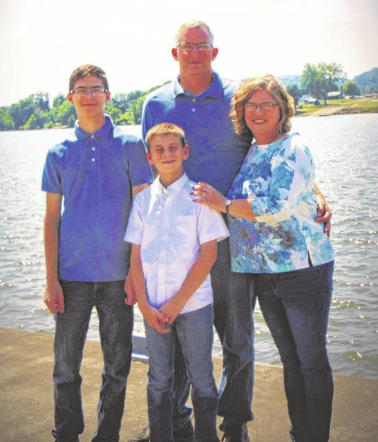 Pastor Rob Grady pictured with his wife Carla and their two sons, Evan and Elijah.