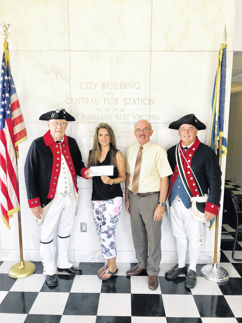 The City of Point Pleasant recently presented the annual donation for the upcoming Battle Days festival to members of the Battle Days committee. Pictured from left to right is Jack Coles, City Clerk Amber Tatterson, Mayor Brian Billings, and Ed Cromley.