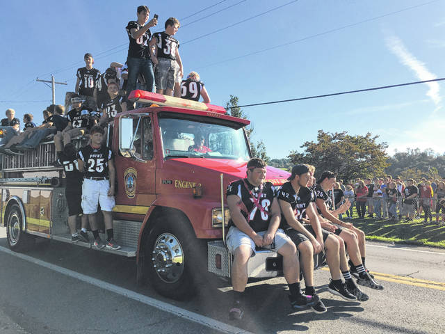 Pictured are members of the PPHS Big Blacks football team in Friday's homecoming parade in Point Pleasant. More photos from the parade appear inside and online at www.mydailyregister.com.