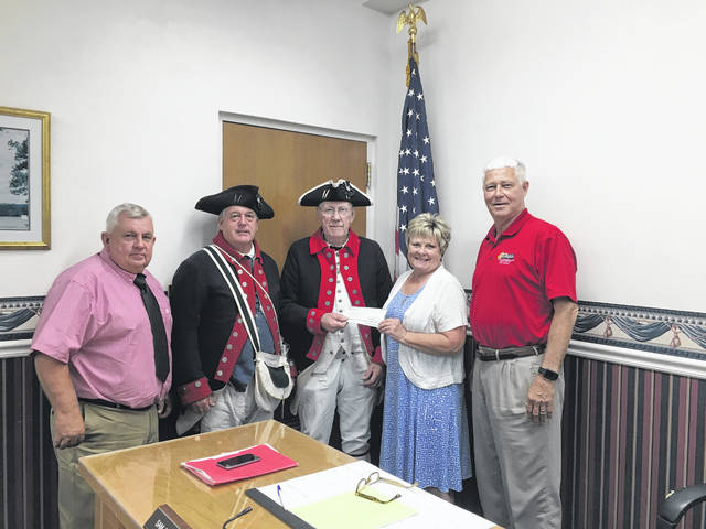 The Mason County Commission recently gave members of the Battle Days committee a $1,000 donation towards the annual Battle Days festival.