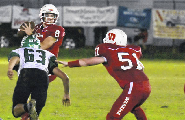 WHS junior Abrahm Pauley (8) prepares to pass during the White Falcons 42-0 setback to Eastern in a Tri Valley Conference Hocking Division contest on Friday night in Mason, W.Va.