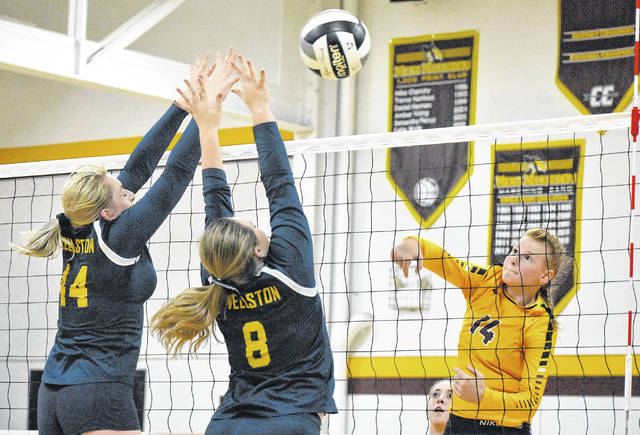 MHS freshman Mallory Hawley (14) attempts a spike during the Lady Marauders setback against Wellston on Tuesday in Rocksprings, Ohio.