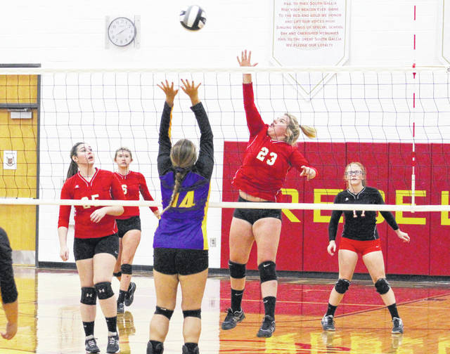 South Gallia sophomore Faith Poling (23) hits a spike attempt over a Southern blocker during Game 1 of Tuesday night's TVC Hocking volleyball match in Mercerville, Ohio.
