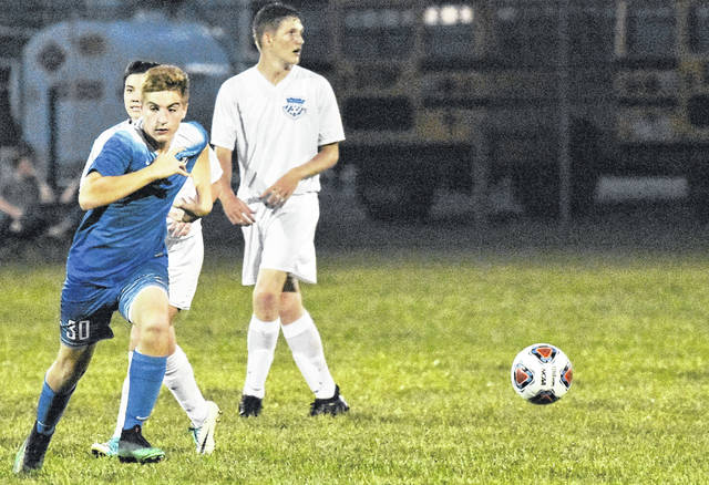 GAHS freshman Seth Nelson races toward the ball during the Blue Devils 9-0 victory over Portsmouth on Thursday in Centenary, Ohio.